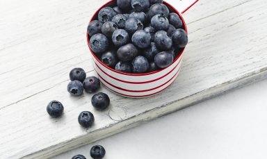 Cup of healthy blueberries